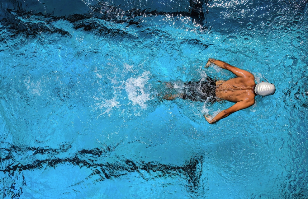 How can cross-training help swimmers?